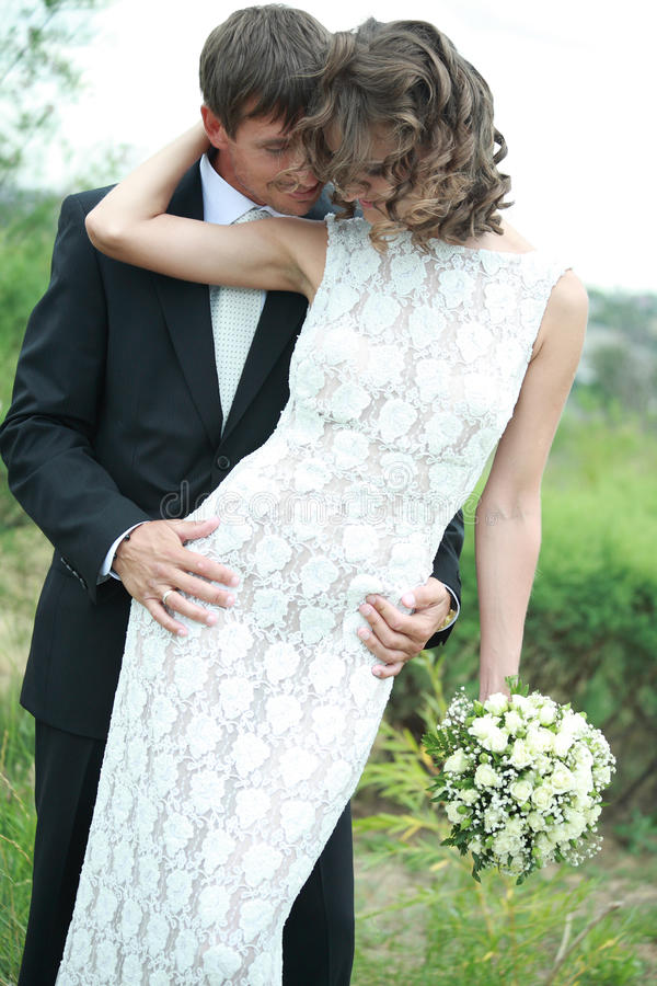 Newlywed couple in love stock images