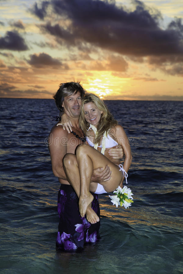 Newlywed Couple In The Ocean Stock Image