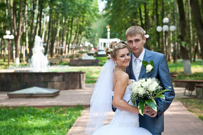 Newlywed couple in a park stock photos