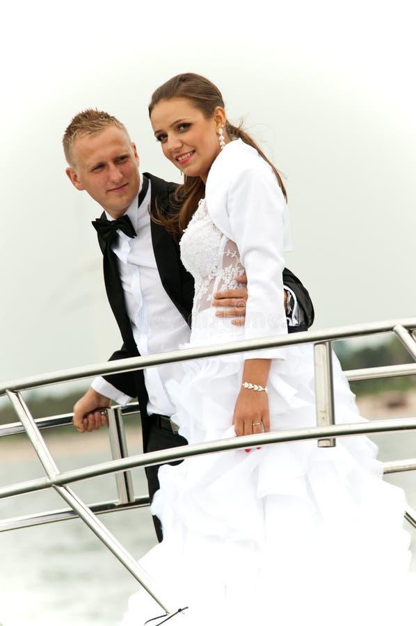 Newlywed couple on speedboat stock photo