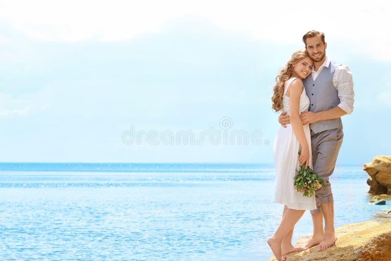 Newlywed couple standing stock image