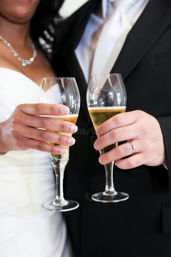 Newlywed couple toasting royalty free stock image