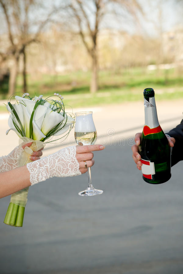 Newlywed's hands stock photo