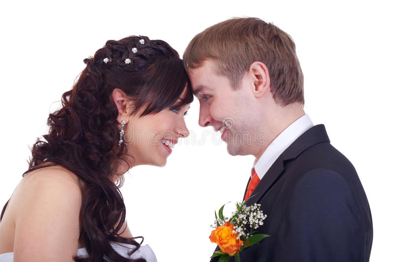 Newlyweds. Happy newlyweds looking at each other royalty free stock image