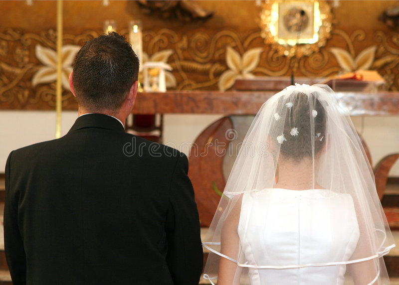 Newlyweds. In the church royalty free stock photos