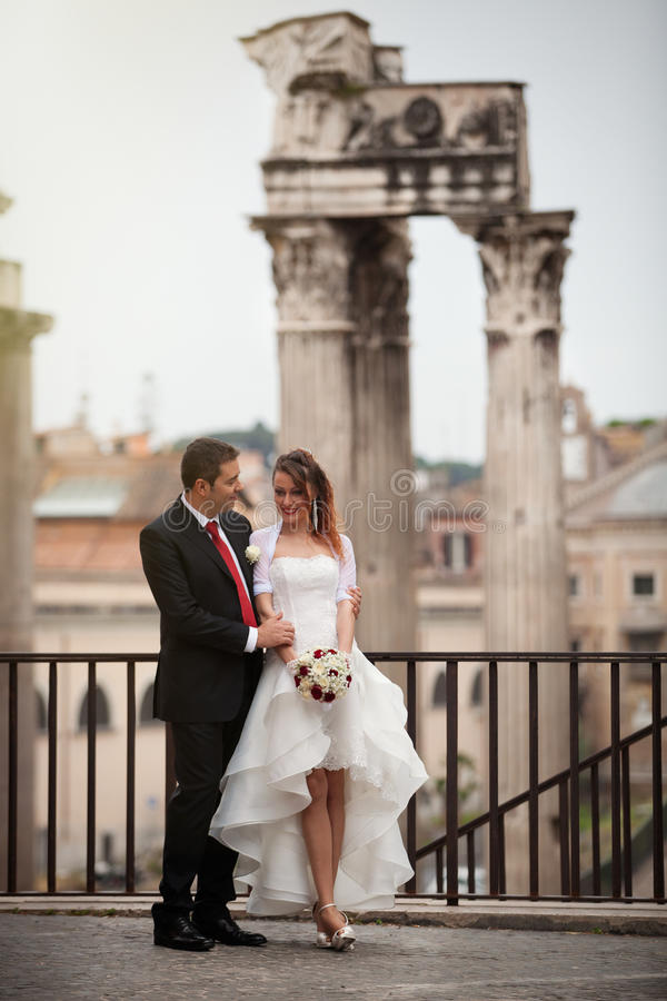 Newlyweds in the ancient city. Happy married couple. Rome, Italy. stock image