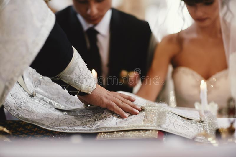 Newlyweds, couple happy at the wedding ceremony in the church. selective focus royalty free stock photography