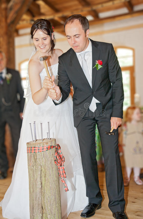 Download Newlyweds Follow Tradition And Drive In Nails Stock Photography - Image: 23443022