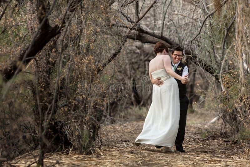Newlyweds in Fun Dance royalty free stock image