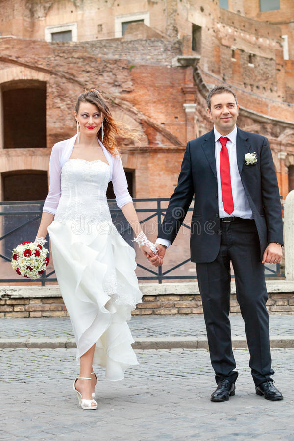 Newlyweds, hand in hand. City. Walking together royalty free stock images