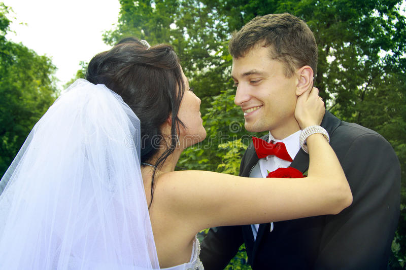 Newlyweds looking to each other with love stock photo