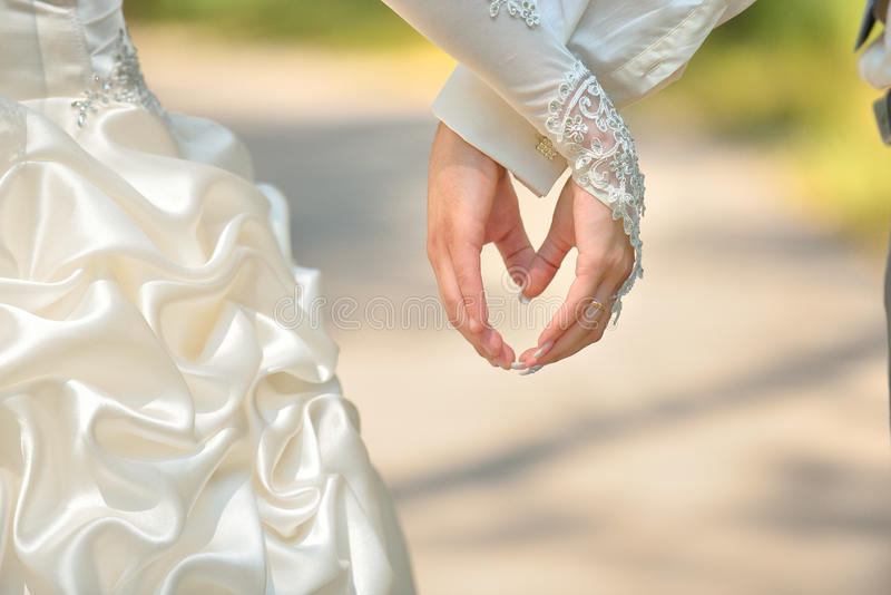 Download Newlyweds make heart hands stock image. Image of nail - 31658159