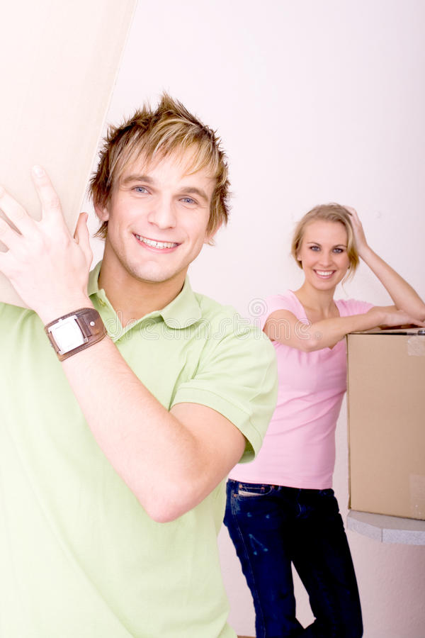 Newlyweds moving house royalty free stock images