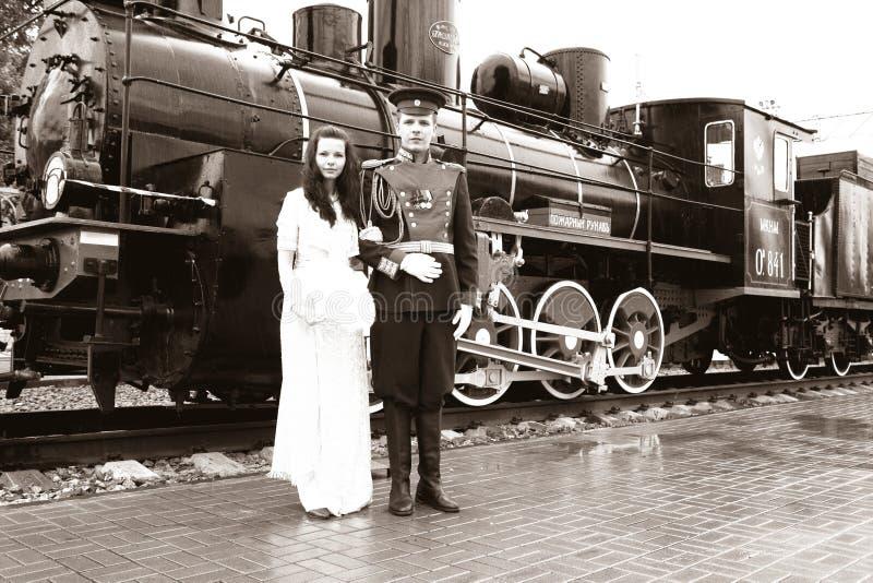 Newlyweds and old engine stock photos