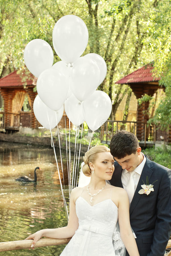 Newlyweds In Park With Balloons Stock Image