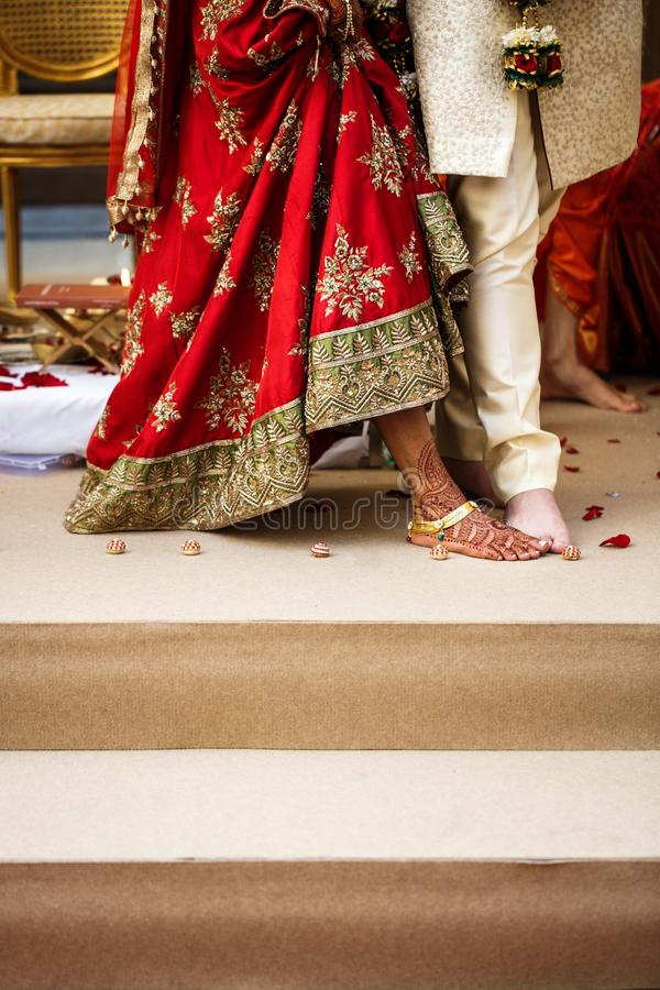 Indian wedding traditions. Bride and groom makes steps together royalty free stock photography