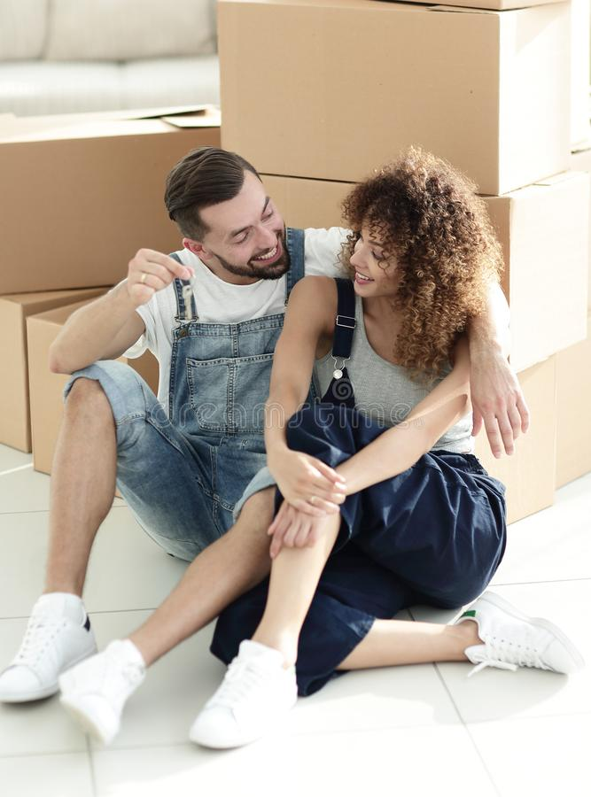 Newlyweds talking while sitting near cardboard boxes royalty free stock images