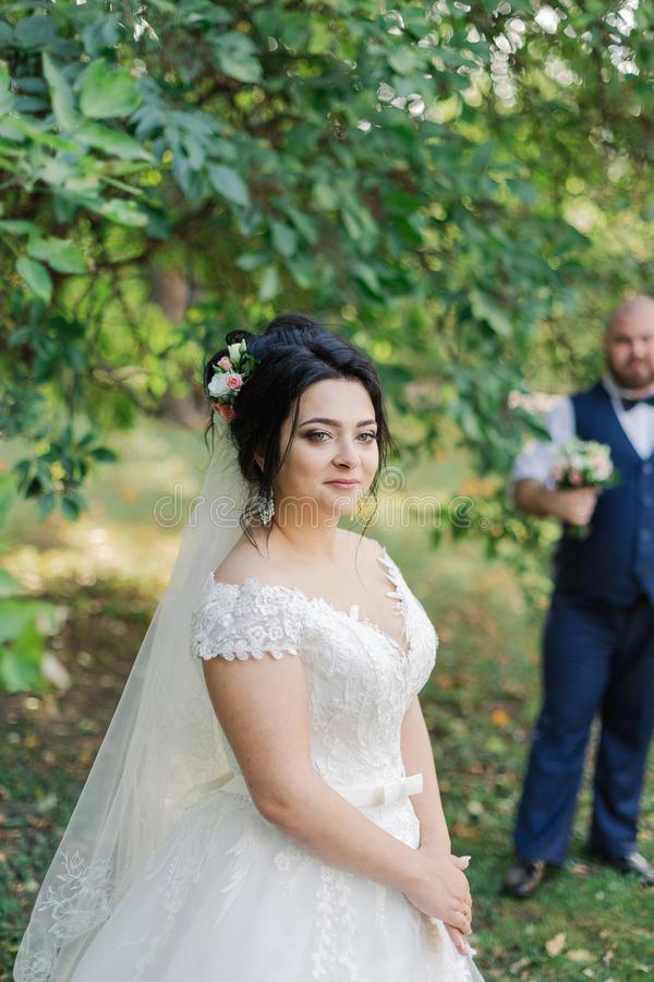 Newlyweds on their wedding day stand apart from each other. stock photography