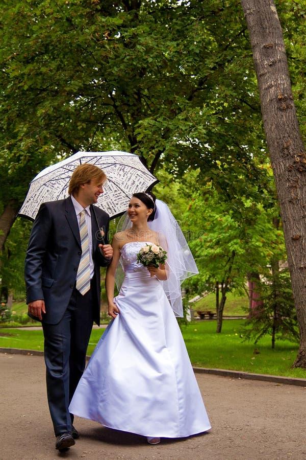 Newlyweds With Umbrella Royalty Free Stock Photography
