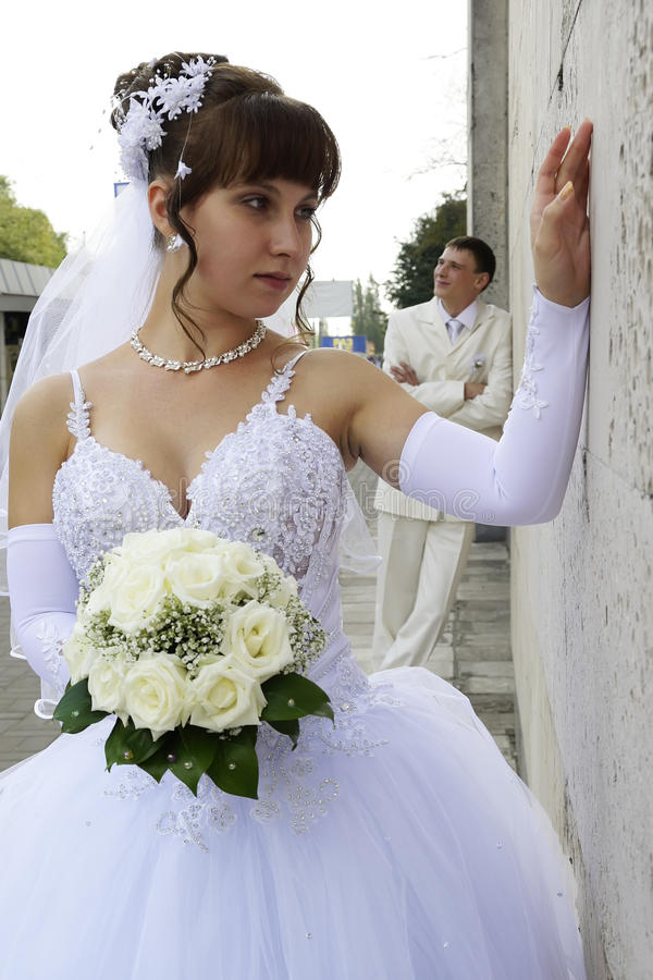 Newlyweds on the walk. Focus on the bride royalty free stock image