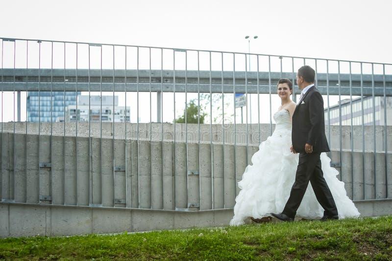 Newlyweds walking in city royalty free stock image