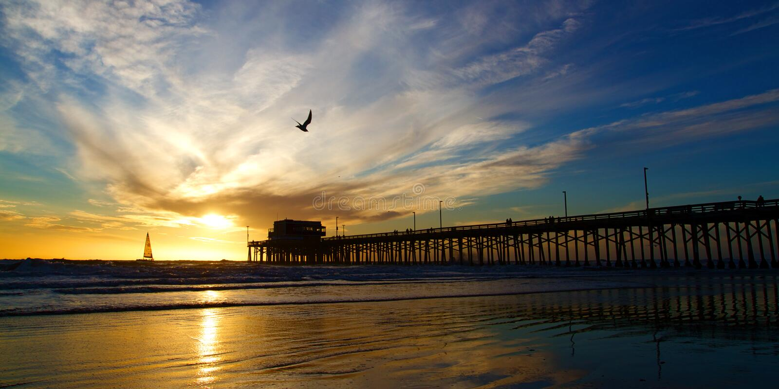 Newport Beach California Pier at Sunset. In the Golden Silhouette stock photos