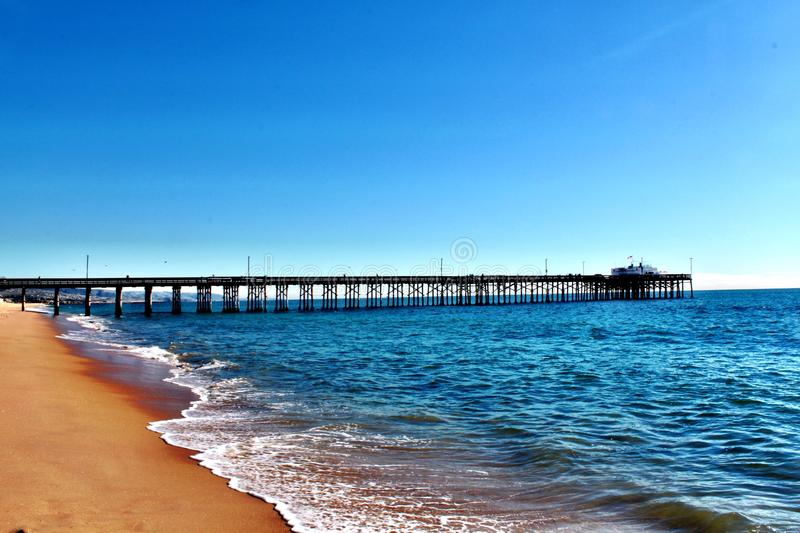 Newport Beach Pier. Pier Jutting out into Pacific Ocean from Newport Beach, California stock photography