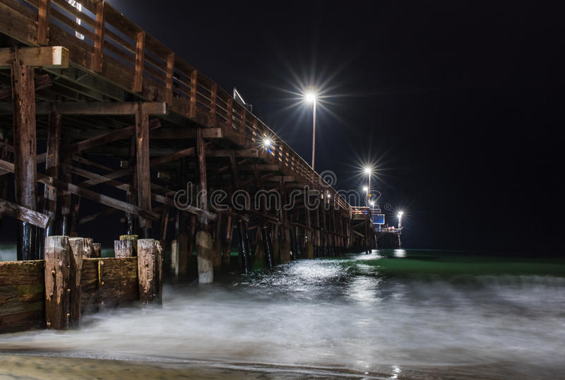 Newport Beach Pier at Night. A long exposure of the historic wooden Newport Beach Pier before sunrise stock photos