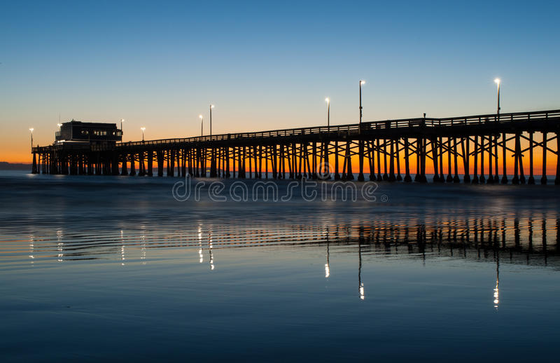Newport beach pier sunset. Newport beach pier in orange county at sunset royalty free stock photo