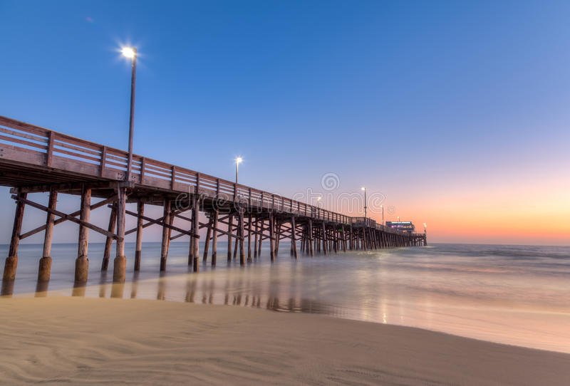 Newport Beach pier at sunset time. Picture of Newport Beach pier at sunset time stock photo