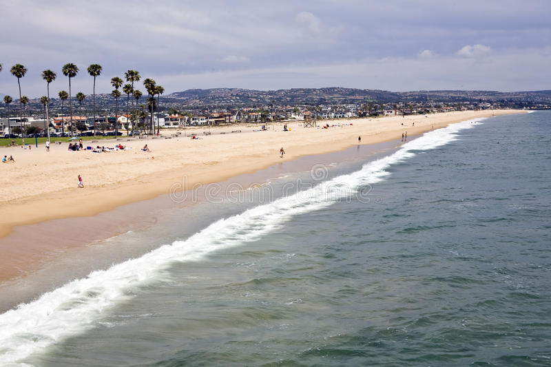 Newport Beach South. Expansive sandy shore attracts sun worshipers to the surf in Newport Beach, California royalty free stock images