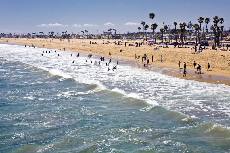 Newport Beach South. Expansive sandy shore attracts sun worshipers to the surf in Newport Beach, California stock photo