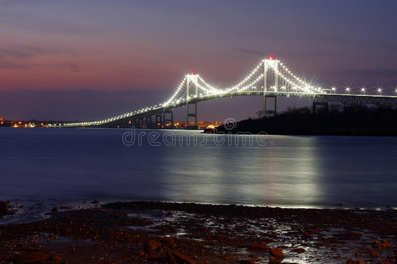 Newport Bridge Sunrise. Taken just as the sun was starting to come up over the horizon and nightfall was slowly fading away royalty free stock photography