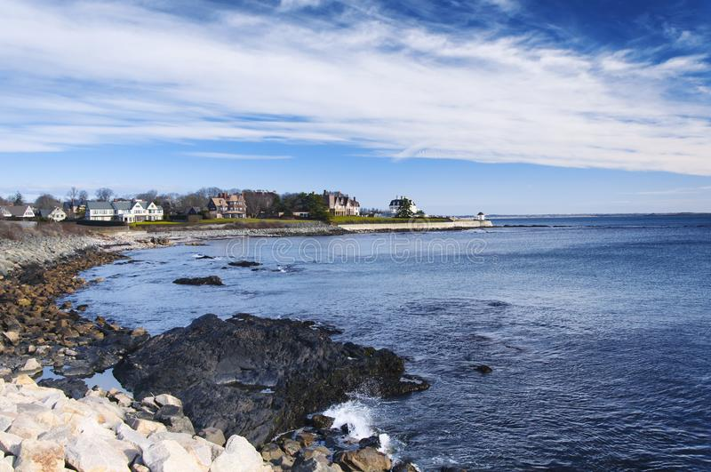 Newport Rhode Island Atlantic Ocean cliffwalk. The rocky coast and cliffwalk of Newport Rhode Island in the united states under blue sky and white clouds royalty free stock photos