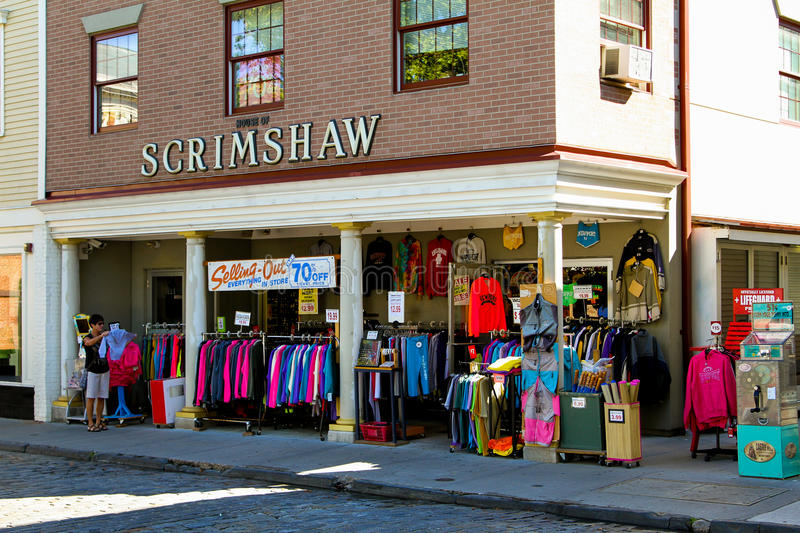 Newport, RI Souvenir store. A souvenir store on Thames Street puts out racks of shirts and sweatshirts at discounted prices to attract visitors to their store royalty free stock image