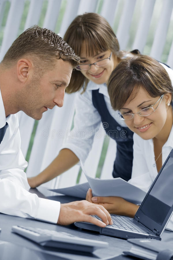 News. Portrait of young business people discussing project in office environment stock photos