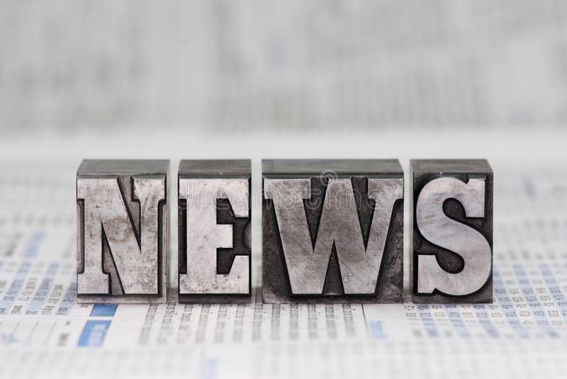 News. The word news in old plumb letters, which were used to print newspapers in the past