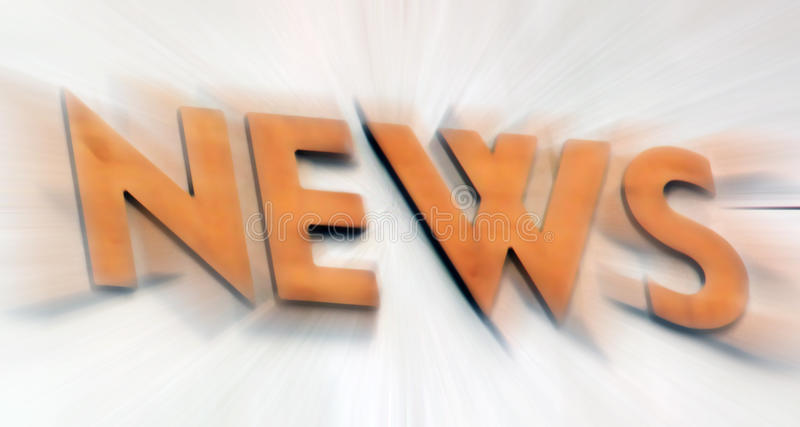 News. The word news in copper orange and radially blurred
