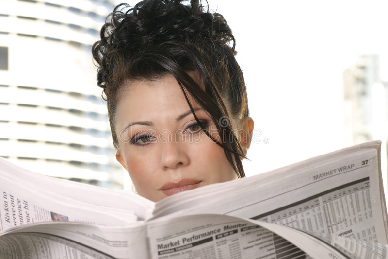 Daily News. Woman reading the newspaper stock photos