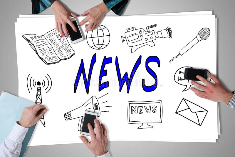 News concept placed on a desk. With hands using smartphones stock images