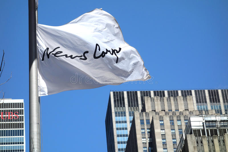 News Corp. The flag of News Corp, a multinational mass media corporation, outside its headquarters in Midtown Manhattan stock photo