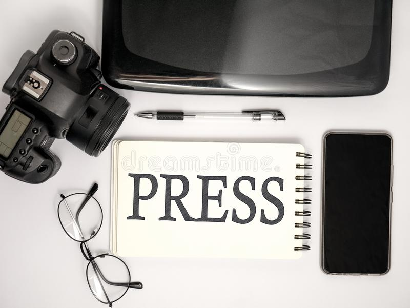 News Journalist Concept, Top View Flat Layout Working Desk. News Maker Concept, Top View Flat Layout Photographer Press Journalist Working Desk. DSLR Camera with royalty free stock photo