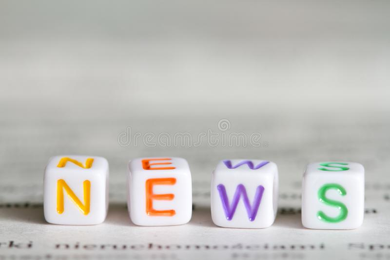News letters text word on defocused newspaper abstract media macro background. Closeup stock photos