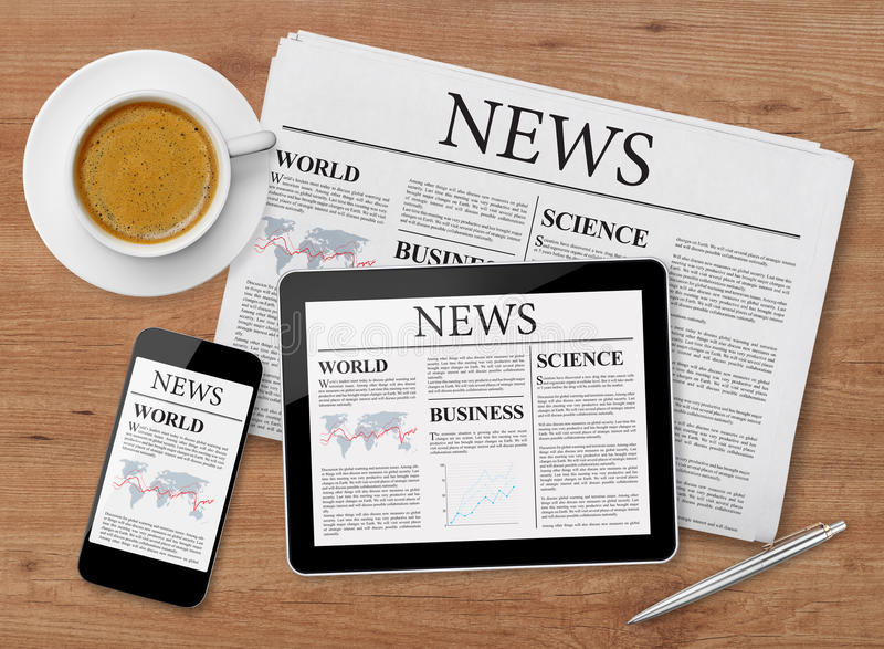 News page on tablet, mobile phone and newspaper stock images