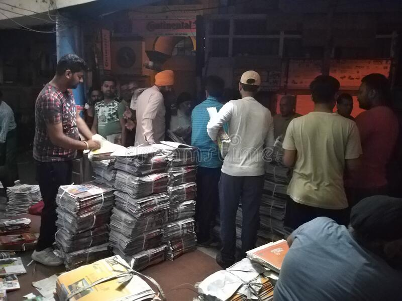 News paper market morning 4 am Jalandhar India. People purchase paper for sales stock photos