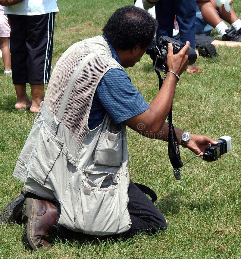 News photographer photographing at a festival royalty free stock images