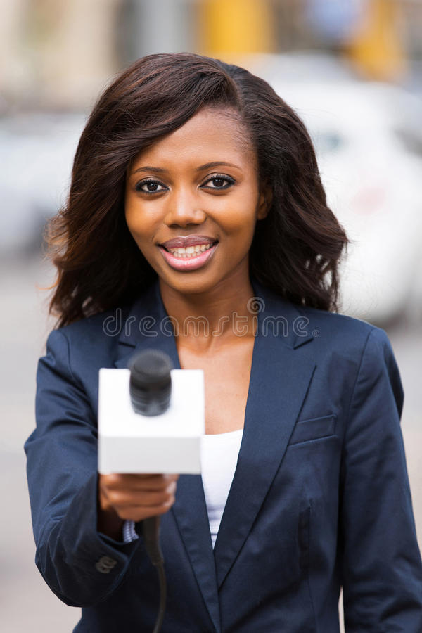 News reporter interviewing stock photography