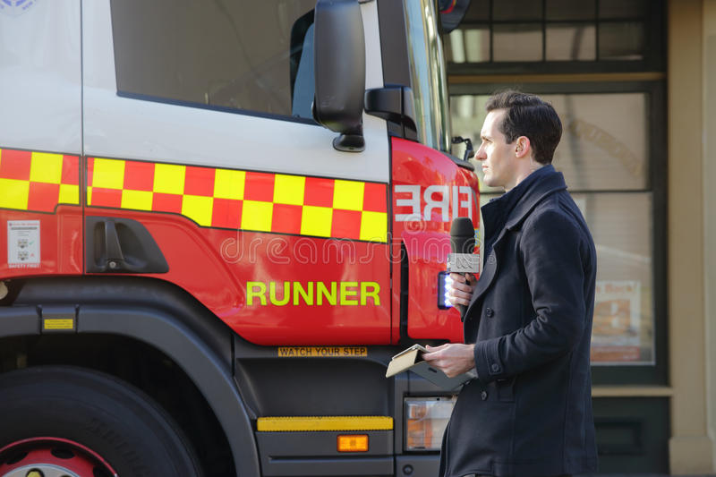 News Reporter at scene covering tragic event stock image