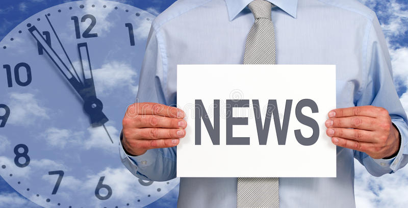 News time. A man holding a sign with the word News with a clock and a blue sky on the background stock photo