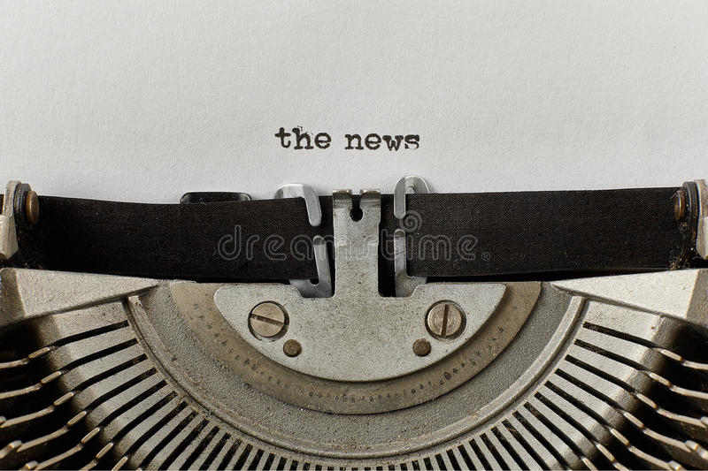 The news typed words on a vintage typewriter stock images